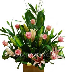 ABC Flowers Magnificent display of premium flowers in colour, texture, and design. The ultimate display of affection! This popular modern presentation of flowers will be certain a great gift - Free Delivery Melbourne Inner Suburbs