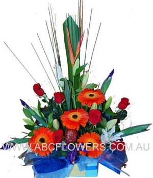 ABC Flowers Melbourne Delivery A sophisticated and elegant gift flower arrangement of lilies, roses, gerberas, iris, and other flowers all in a classic box. Orange, Purple and deep reds in a passionate mixture of rich colour and texture Free Delivery Melbourne Inner Suburbs