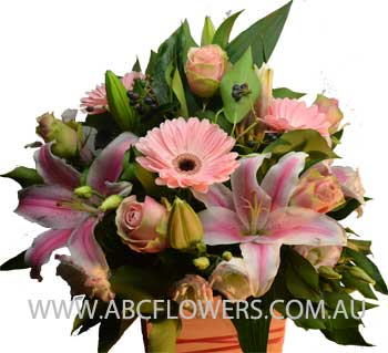 A014 Dockland a beautiful centre piece arrangement with pink lilies pink roses pink gerbeara and pink lisianthus