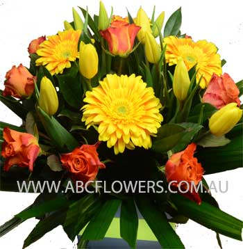 ABC Flowers St. Vincent's Hospital Melbourne Deliver A030 centre piece flowers arrangement with yellow tulips orange gerberas melbourne wide
