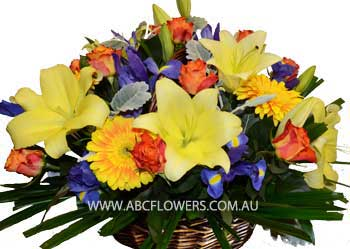 BA004 Lucie - Bright basket of lilies, roses, iris, and gerberas  Free Delivery Melbourne Inner Suburbs